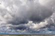 Leinwandbild Motiv Large Cumulus clouds, dramatic sky. Background image.