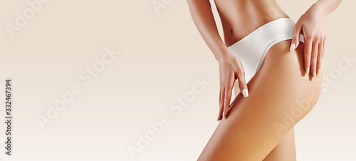 Obraz Spa and wellness. Healthy slim body in white panties. Beautiful sexy hips with clean skin. Fitness or plastic surgery. - fototapety do salonu