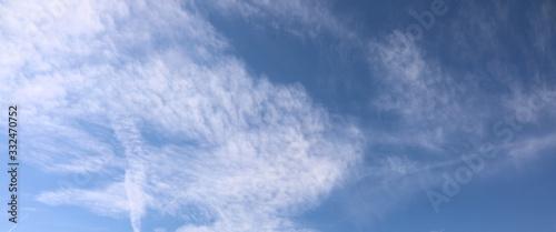 Fototapeta beautiful very high white clouds in the blue sky in summer ideal