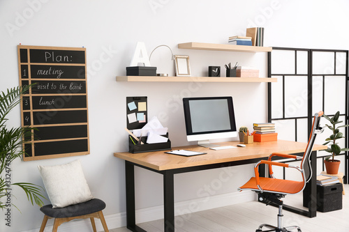 Fotografia Modern computer on table in office interior. Stylish workplace