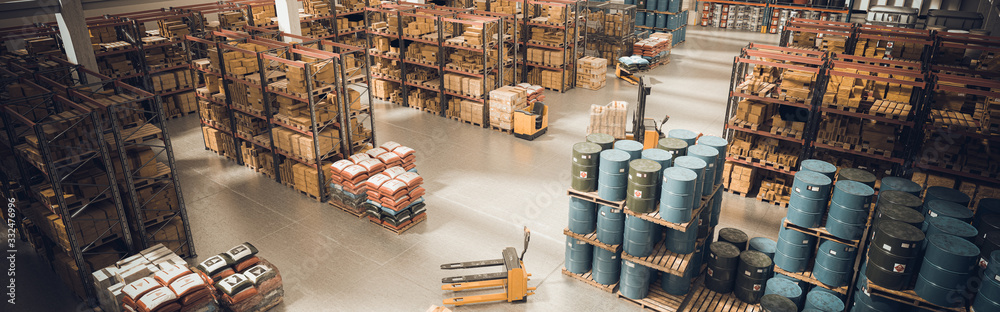 Fototapeta interior of a large warehouse with stored material and means for moving the pallets.