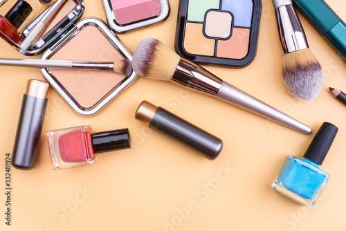 Flat view of cosmetics - lipstic, face-powder, brushes, nail polish Canvas Print