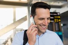 Man Talking On Mobile Phone At...