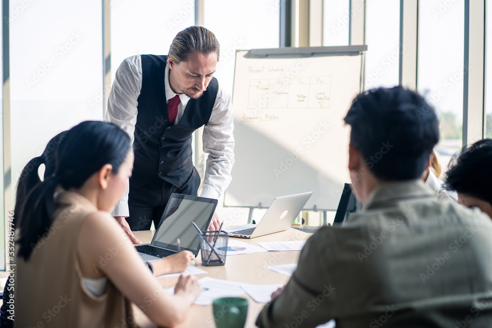 Fototapeta Group leader man and teamwork brainstorm to solve problem and presentation new idea. People conference other on new challenge topic meeting room. Business finance and communication planning concept.