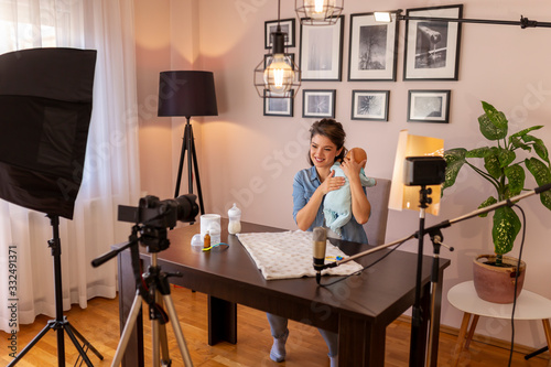 Vlogger recording video about baby burping positions Fototapet
