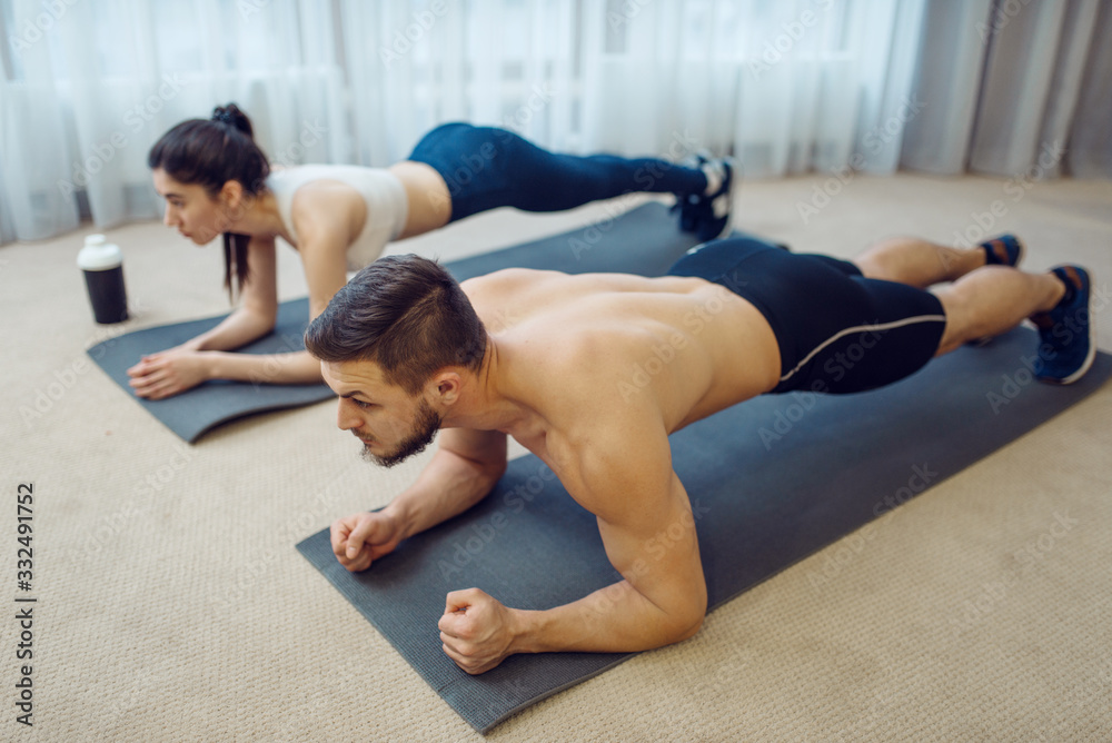 Fototapeta Morning fitness workout of family couple at home
