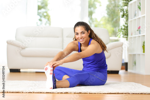 Fototapeta Happy woman stretching after exercise at home obraz
