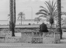 An Old Man Staring At The Med...