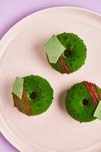 Donuts With Green Icing On Plate