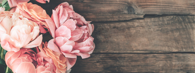 Fresh bunch of pink peonies and roses on wooden rustic background. Card Concept, pastel colors, close up image, copy space