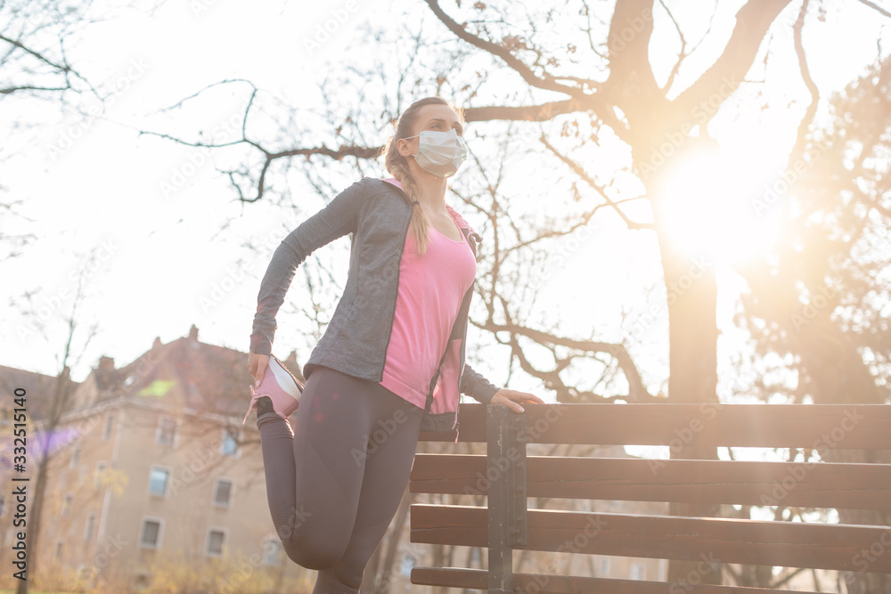 Fototapeta Woman during coronavirus crises exercising outdoors