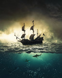 Sailing ship with sharks underwater