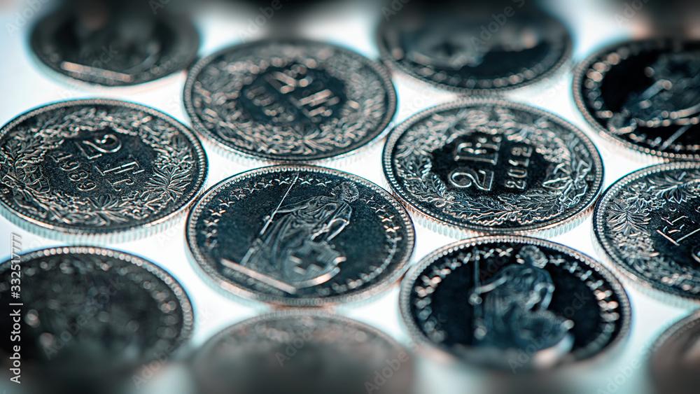 Fototapeta Swiss coins two francs lie on a light background.