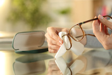 Woman Hands Cleaning Glasses With Tissue At Home