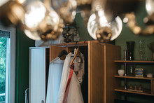 A Wedding Dress Hung In A Room