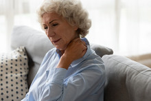 Sick Old Woman Sit On Couch In...