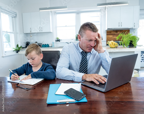Fototapety, obrazy: COVID-19 school lockdowns and remote working. Stressed man trying to work from home with bored son