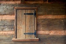 Aged Wooden Log Cabin Window, Brown Wood With Clay And Black Hinges