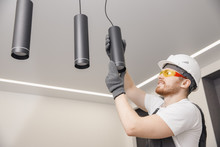Electrician Worker Installation Electric Lamps Light Inside Apartment. Construction Decoration Concept
