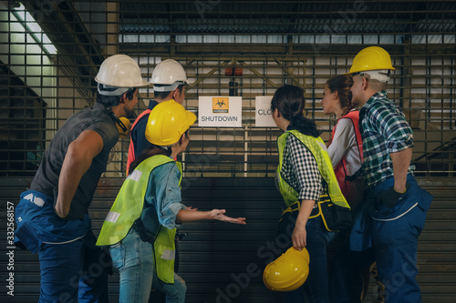 Fototapeta factory workers at factory with annoucement of factory closed due to problem from coronavirus covid 19 outbreak with depressed feeling of job losing and unemployment, problem from coronavirus outbreak obraz