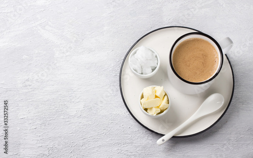 Bulletproof coffee in white ceramic cup blended with butter and coconut oil Wallpaper Mural