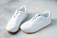 Pair Of White Athletic Sneakers