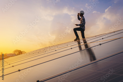 Fototapeta Electrical, instrument technician relax after work day done, maintenance electric system at solar panel field obraz