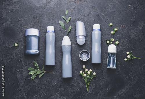 Photo Different deodorants on dark background