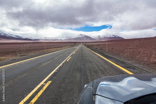 Obraz Road in Atacama desert savanna, mountains and volcano landscape, Chile, South America - fototapety do salonu