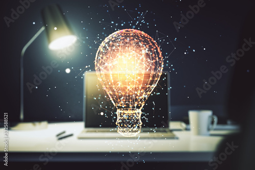 Obraz Creative light bulb hologram on modern laptop background, idea concept. Multiexposure - fototapety do salonu