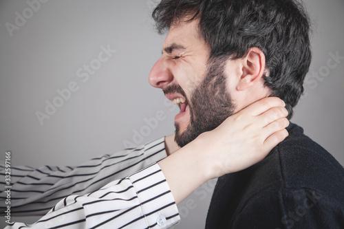 Valokuvatapetti Woman strangling caucasian man in home.