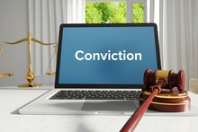 Conviction – Law, Judgment, Web. Laptop In The Office With Term On The Screen. Hammer, Libra, Lawyer.