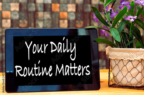 Carta da parati your daily routine matters concept on tablet