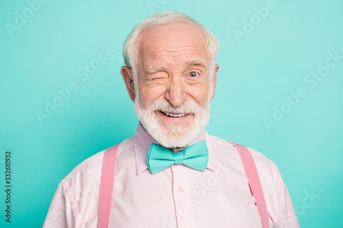 Obraz Close up photo of imposing dreamy candid old man wink blink enjoy cool best weekend wear good look clothing isolated over green color background - fototapety do salonu