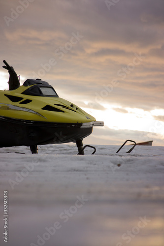 Parked snowmobile shot from worm's view in the morning Canvas Print