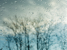 Wet Window With Rain Drops And...