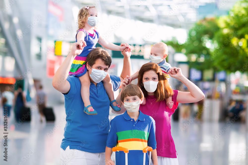 Fototapeta Family in airport in face mask. Virus outbreak.