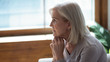 canvas print picture - Profile unhappy upset older woman sitting alone and thinking about problems, feeling lonely, suffering from depression, dementia or mental disorder, frustrated mature female looking in distance