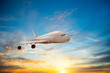 Passengers commercial airplane flying in sunset