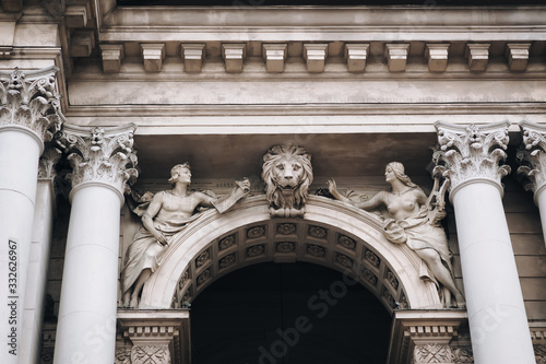 Vászonkép The sculpture muse of allegory of arts and lion on the facade of the Opera and Ballet Theater in Lviv