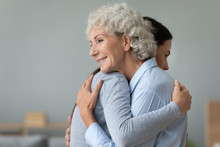 Happy Elderly Mom And Grown-up Daughter Hug Embrace Make Peace After Fight, Supportive Mature Mother And Adult Girl Child Cuddle Reconcile Share Close Intimate Moment Support Concept