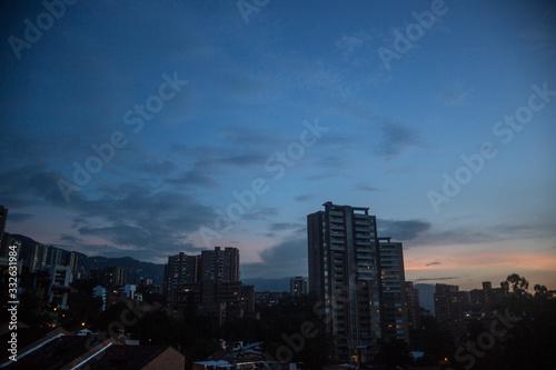 Night falls over the skyscraper apartments of the affluent barrio of El Poblado Canvas Print