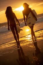 Two Women Bikini Surfers With...