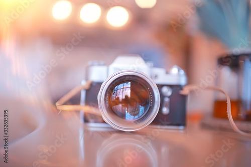 Tela blurred background with vintage camera / photo old camera, unusual vintage, hips