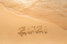 Lettering On The Beach With Wa...