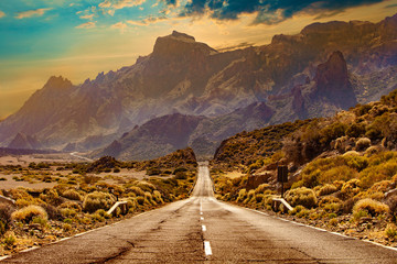 Fototapeta Wiejski Image related to unexplored road journeys and adventures.Road through the scenic landscape to the destination in Tenerife natural park.