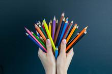 Bunch Of Colored Pencils In Ha...