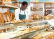 Baker arranging showcase in bakery