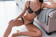 Slender Woman In Black Underwear Leaning On Bed Indoors In Room At Daytime