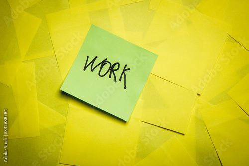 Green sticky note with word work on yellow notes